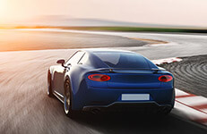 car, blue sports car driving on racetrack, photorealistic 3d render, generic design, non-branded
